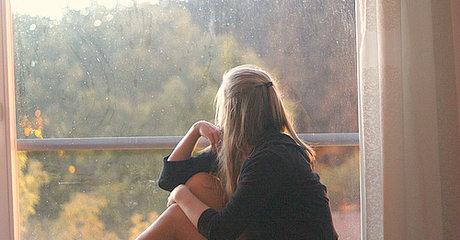 Staring out window woman rain