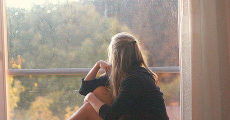Staring out window woman rain
