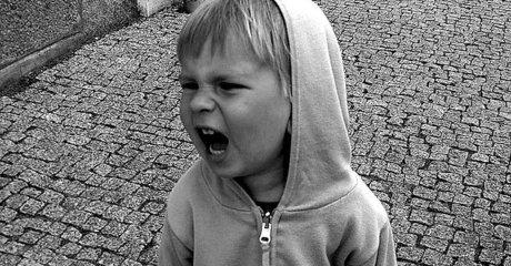 Angry child boy yelling